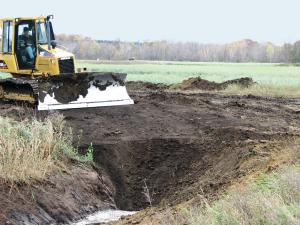 Vegetation Establishment and Maintenance Wetland Establishment Scraping Reed Canary Grass