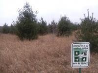 RIM easement sign on ACUB site with trees